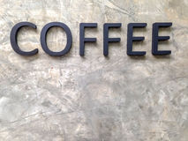 Letter coffee on the wall of cement Royalty Free Stock Photo