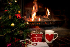 Letter, cookies and milk for Santa Claus below Christmas tree Stock Photos