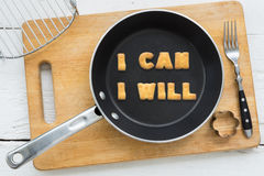 Letter cookies quote I CAN I WILL and kitchen utensils Stock Photos