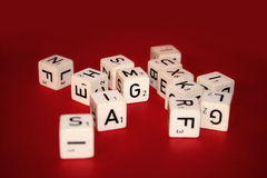 Letter cubes. Cube with letters on a red background Royalty Free Stock Image