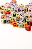 Letter Cubes. An assortment of letter cubes against a white background Stock Photography