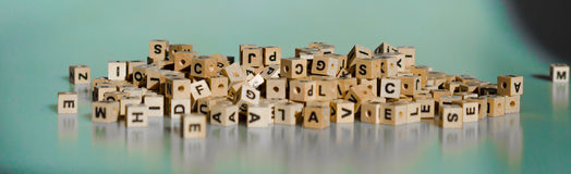 Letter Cubes. On blue background royalty free stock photos