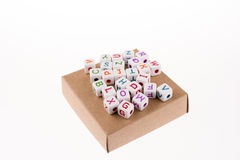 Letter cubes on a box Royalty Free Stock Photography