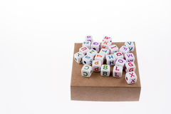 Letter cubes on a box Stock Photography