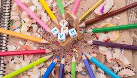 Letter cubes on chair in pencil trash. Colorful letter cubes on chair in pencils and trash Stock Images