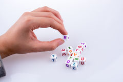 Letter cubes. Hand playing with Letter cubes on a white background Stock Images