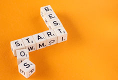 Letter Cubes Spell Best, Start, SOS Stock Images