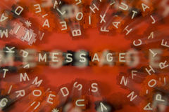 Letter cubes spell out message. A bunch of scattered letter cubes spelling out message Stock Photos