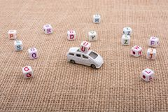 Letter cubes and toy car as a transportation device. Letter cubes and  tiny toy car as a transportation device Stock Photos