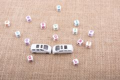 Letter cubes and toy car as a transportation device. Letter cubes and  tiny toy car as a transportation device Royalty Free Stock Photo