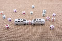 Letter cubes and toy car as a transportation device. Letter cubes and  tiny toy car as a transportation device Royalty Free Stock Images