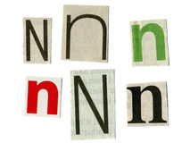 Letter cut from newsprint Stock Photo