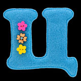 Letter of the Cyrillic alphabet made of felt isolated on black. Letter of the alphabet made of blue felt isolated on black background. Cyrillic Russian alphabet stock image