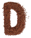 Letter D made with Linseed also known as flaxseed isolated on wh Stock Photos