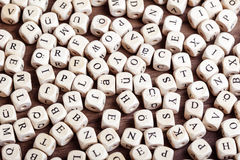 Letter dices chaos. Text concept macro: Letter dices lying in chaos on table Royalty Free Stock Photo