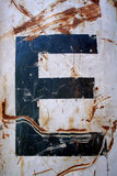 The letter E. On a rusty container Stock Photo