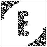 The letter E. Decorative Font with swirls and floral elements. Vintage style.  Royalty Free Stock Images