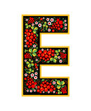 Letter E in the Russian style. The style of Khokhloma on the font. A symbol in the style of a Russian doll on a white background. The font of the football Royalty Free Stock Images