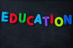 Letter education block on slate Royalty Free Stock Photography