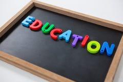 Letter education block on slate Stock Photos