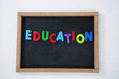 Letter education block on slate Stock Images
