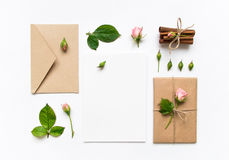 Free Letter, Envelope And Gift On White Background. Invitation Cards, Or Love Letter With Pink Roses. Holiday Concept, Top View, Flat L Stock Photo - 83499230
