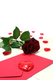 Letter with envelope, red roses and red hearts. On white background stock image