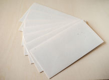 Letter envelope on wood table Stock Photos