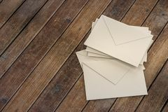 Letter envelopes for mail postage on wooden table.  Royalty Free Stock Images