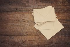 Letter envelopes for mail postage on wooden table.  Stock Images