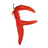 Letter F composed of red chili peppers Stock Images