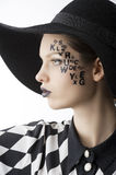 The letter on the face creative makeup girl Stock Image