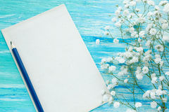 Letter flowers.  Blue wood background. Top view. mockup Royalty Free Stock Photo