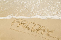Letter Friday on the beach. Stock Images