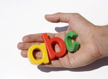 Letter fridge magnets in hand Stock Photo