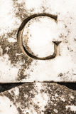 Letter G Carved in Marble Stock Photo