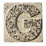Letter G carved in a concrete block Royalty Free Stock Photos