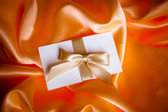 Letter with golden ribbon Royalty Free Stock Photography