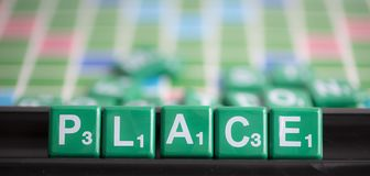 Letter green scrabble is spelling word PLACE. Placement or distribution is a very important part of the product mix definition. You have to position and royalty free stock photography