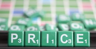Letter green scrabble is spelling word PRICE. The price of the product is basically the amount that a customer pays for to enjoy it. Price is a very important royalty free stock photo