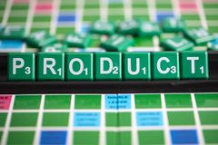 Letter green scrabble is spelling word PRODUCT on the rack. PRODUCT in marketing mix 4p. A product is an item that is built or produced to satisfy the needs of a stock photography