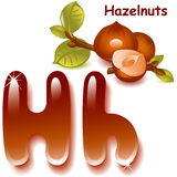 Letter H. Alphabet. English capital and uppercase letter H, stylized color of hazelnut. hazelnut with shell and half nuts. vector illustration Stock Photography