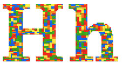 Letter H built from toy bricks in random colors Royalty Free Stock Photography