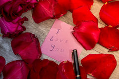 Letter with I love you note, red rose and pen. Royalty Free Stock Photo