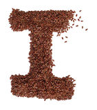 Letter I made with Linseed also known as flaxseed isolated on wh Stock Photo