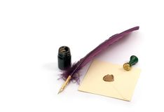 Letter, Inkwell and feather. Studio. Isolated. Still-life about a  letter with a quill, an inkwell & a stamp Royalty Free Stock Images