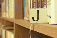 Letter J. In a very nice bookshelf stock photo