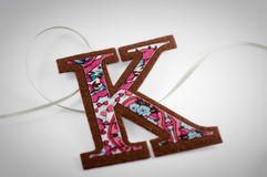 Letter K. A felt cut out of the letter K stock images