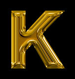 Letter K rounded shiny golden isolated on black. Background Royalty Free Stock Photo