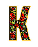 Letter K in the Russian style. The style of Khokhloma on the font. A symbol in the style of a Russian doll on a white background. Royalty Free Stock Photo